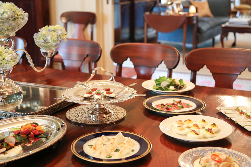 A spread of small plates can be prepared for guests to snack on before dinner